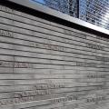Maison de quartier à Villefontaine (38) - Agence Loup Menigoz à Chambery (73) - 1.200 m² de Briques BlocStar Am90 anthracites dont 3/4 en parement lisse et 1/4 en parement Clivé